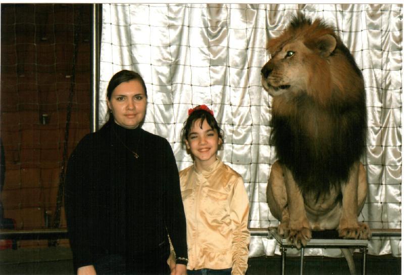 В клетке со львом